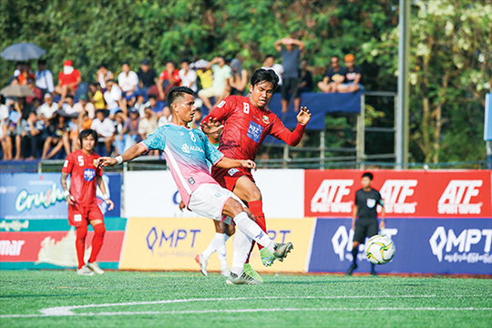 Shan United striker Zin Min Tun (red) vies for the ball with Yangon United's Soe Min Naing (green) at their previous meeting on 5 January in the Charity Cup 2020.  Photo: MNL