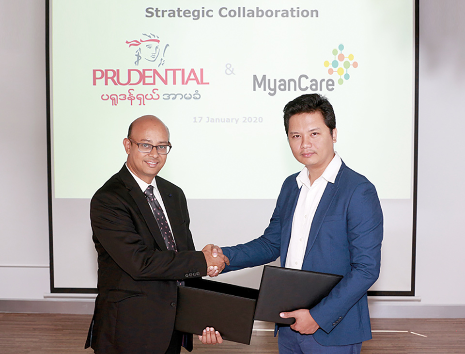 Mr Asit Rath, CEO of Prudential Myanmar and U Zaw Min Tun, CEO of Myan Care shake hands during the signing ceremony of MoU.Photo:  Prudential Myanmar.