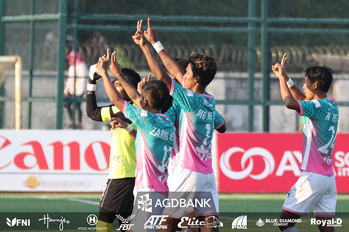 Yangon United players celebrate their 2-0 victory over Sagaing United yesterday at the Yangon United Sports Complex.Photo: YUFC