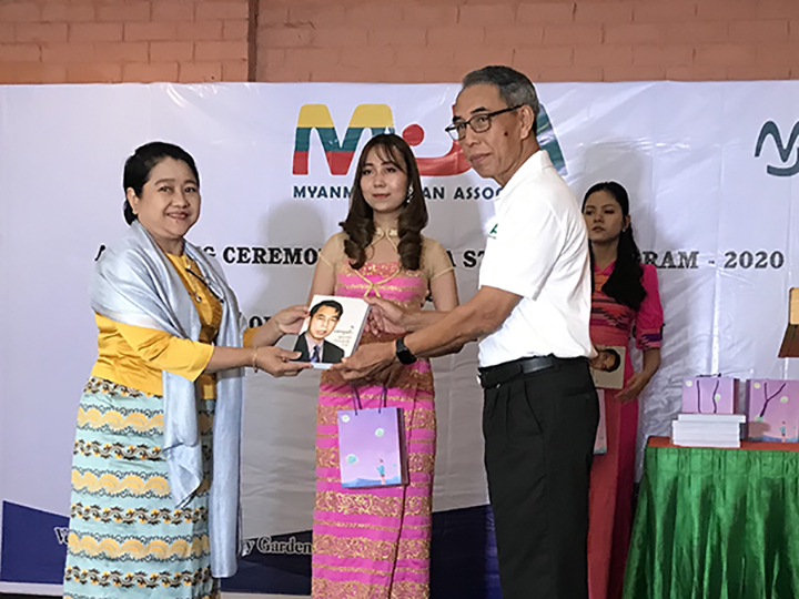 """Chairman of the Myanmar-Japan Association, U Saw Hla Min, hands over his book entitled """"My Diplomatic Journey"""" to an official.Photo: mna"""