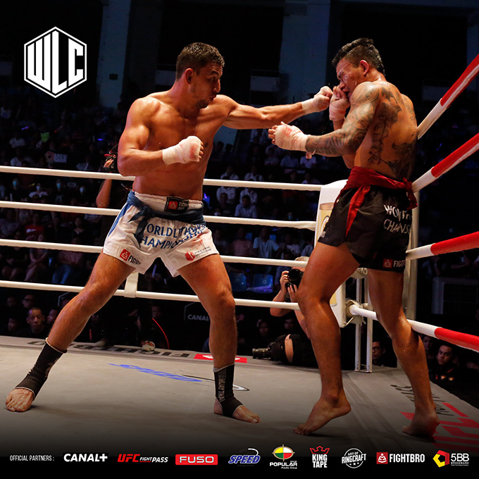 Ukraine fighter Naimjon Tuhtaboyev (L) lands a punch on Myanmar lethwei fighter Too Too (R) during the main bout of the World Lethwei Championship.  Photo: WLC