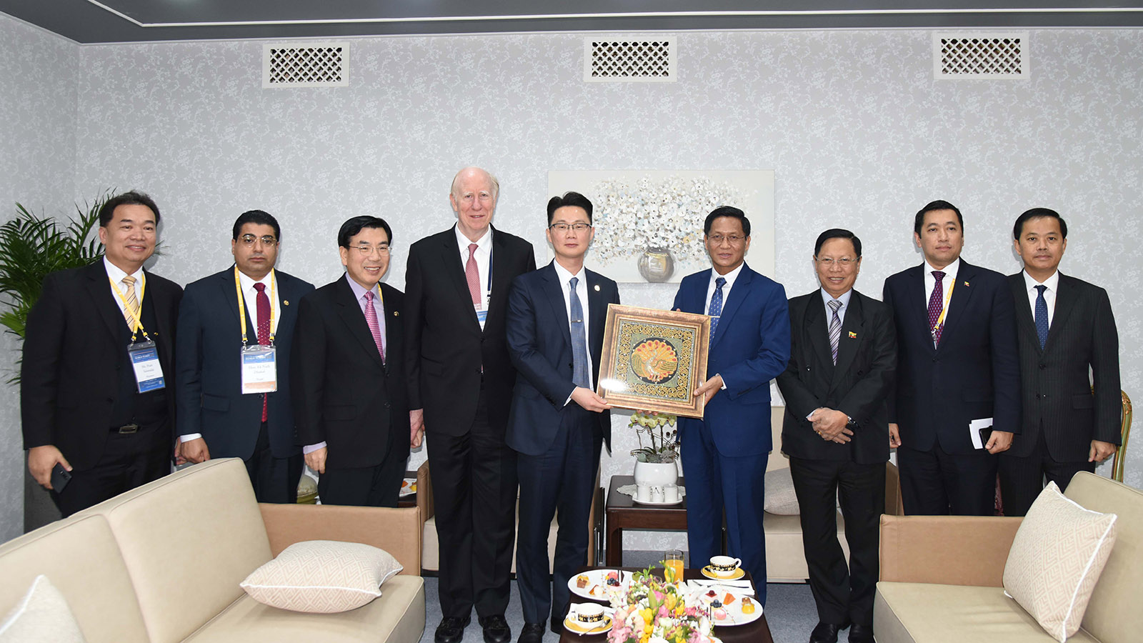 Vice President U Henry Van Thio presents the gift to the Universal Peace Federation yesterday. Photo: MNA