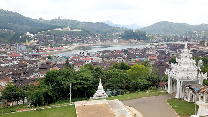 Panoramic scenery of Mogok town viewing from a hilltop pagoda.