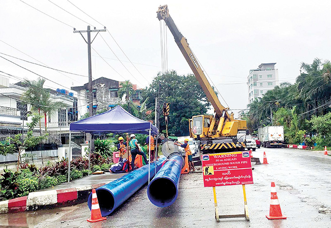 Municipal workers are in process of laying water pipelines to supply drinking water in Yangon municipality.