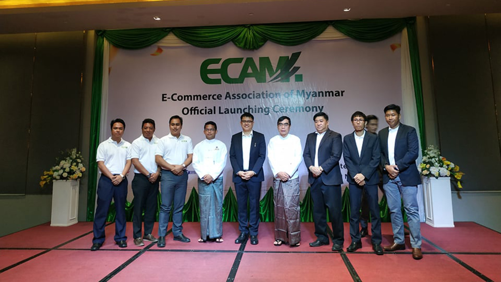 Attendees pose for a group photo at the official launching ceremony of E-Commerce Association of Myanmar (ECAM) at the Novotel Hotel on Pyay Road in Yangon yesterday. Photo: GNLM