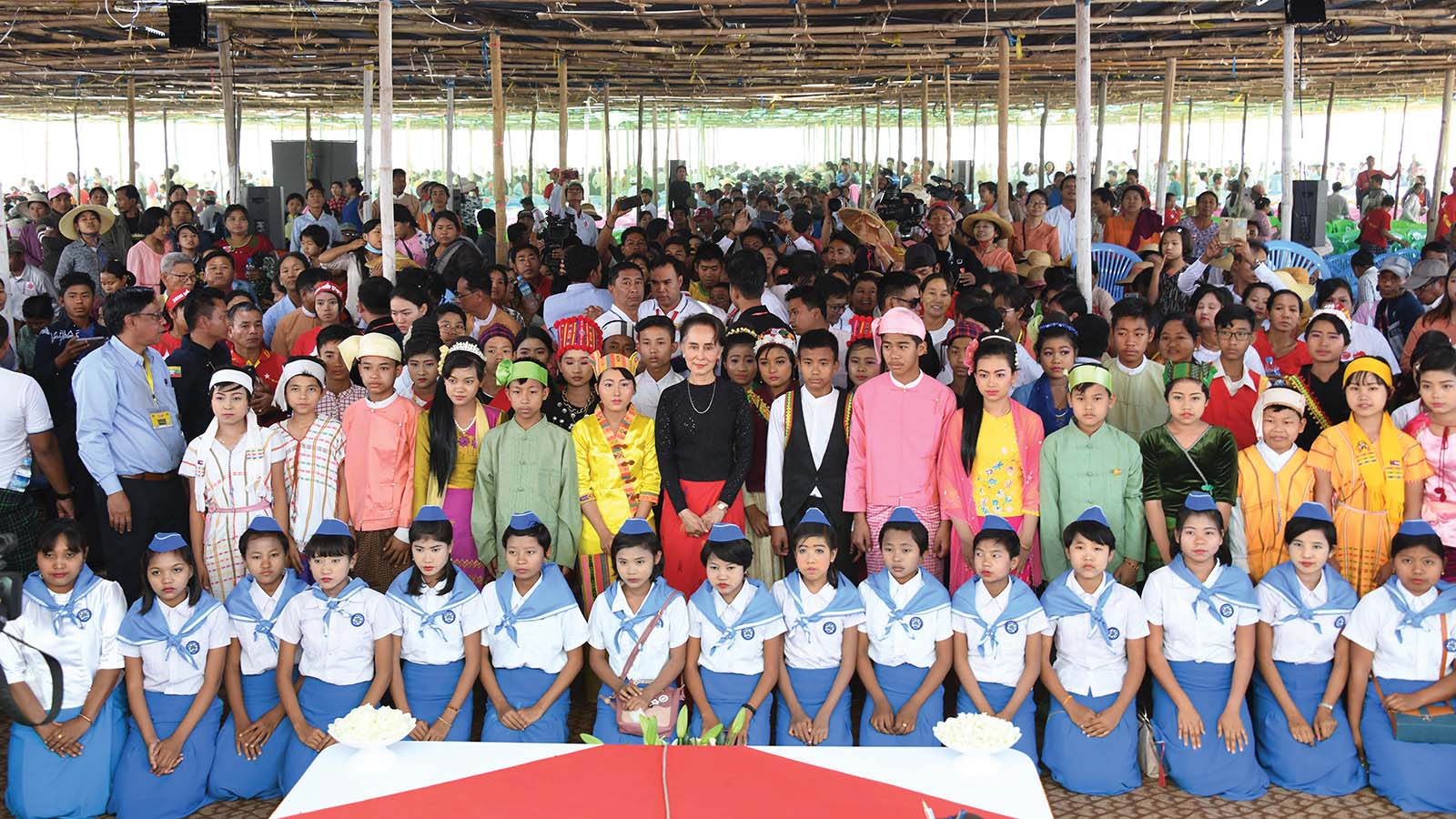State Counsellor Daw Aung San Suu Kyi poses for the documentary photo with children at the meeting with locals in Dabayin.Photo: MNA
