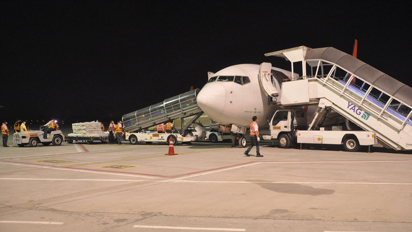 A cargo plane carrying raw materials for garments in Myanmar lands at Yangon International Airport.Photo: Than Htaik