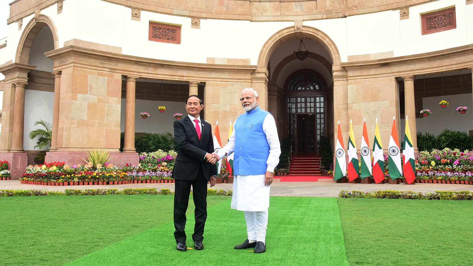 President U Win Myint shakes hands with Indian Prime Minister Shri Narendra Modi in New Delhi, India on 27 February. Photo: MNA