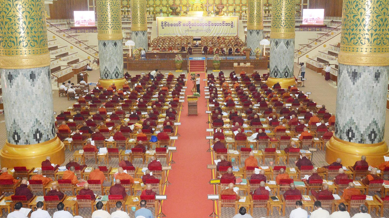 The first day of the second regular meeting of the 8th State Central Working Committee of Sangha is in progress at the Maha Pasana Cave in the precinct of Kaba Aye Pagoda in Yangon yesterday.  Photo: MNA