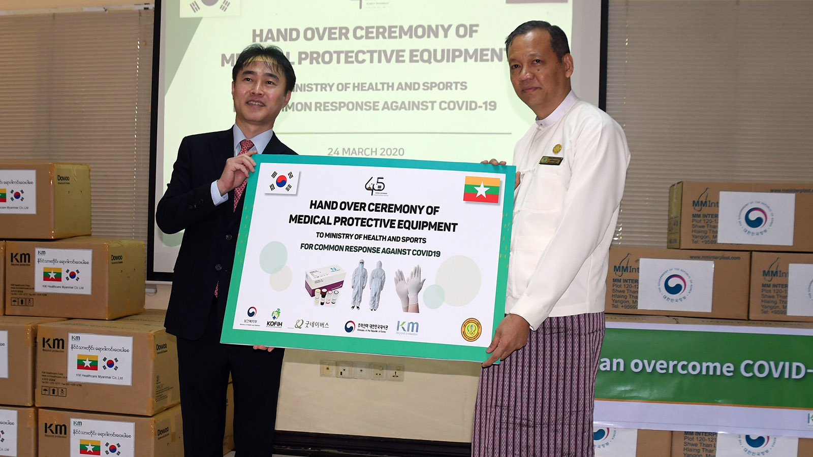 Amb. Mr Lee Sang-hwa donates COVID-19 protective equipment to Dr Zaw Than Tun of Medical Research Department.  Photo: Nay Lin