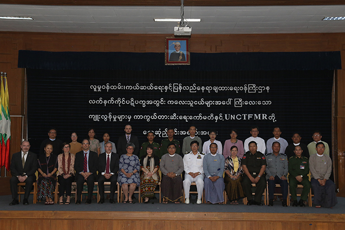 Union Minister Dr Win Myat Aye, officials from UN Country Task Force on Monitoring and Reporting and officials pose for a group photo at the coordination meeting in Nay Pyi Taw yesterday.  Photo:MNA
