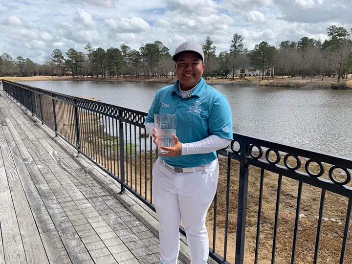 Myanmar golf player Phue Pwint Yati Khaing seen with the River Landing Classic Cup. Photo: MGF