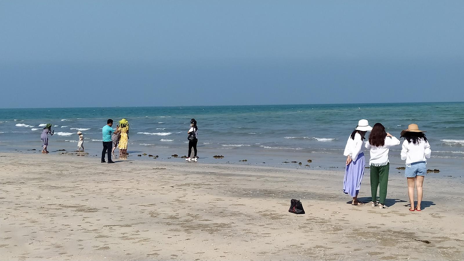 Visitors taking photo at the Shwe Thaung Yan Beach. Photo: ko ko maung