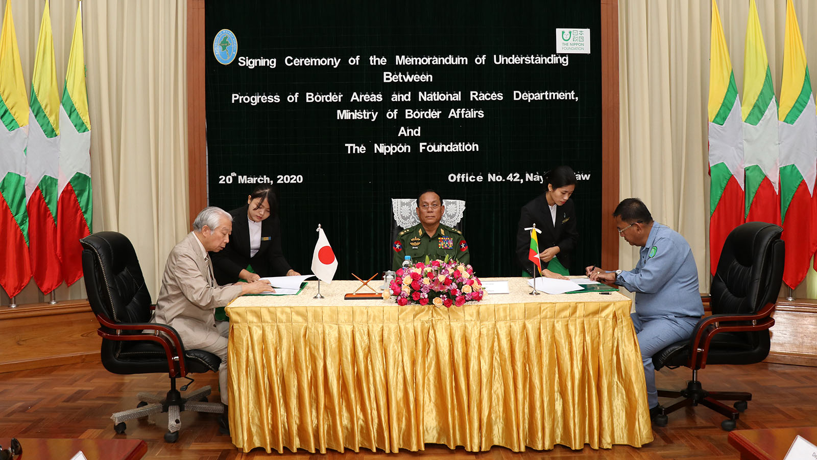 Director-General U Ye Naing of rogress of Border Areas and National Races Department and Mr Yuji Mori signing the MoU documents in Nay Pyi Taw yesterday.Photo: MNA