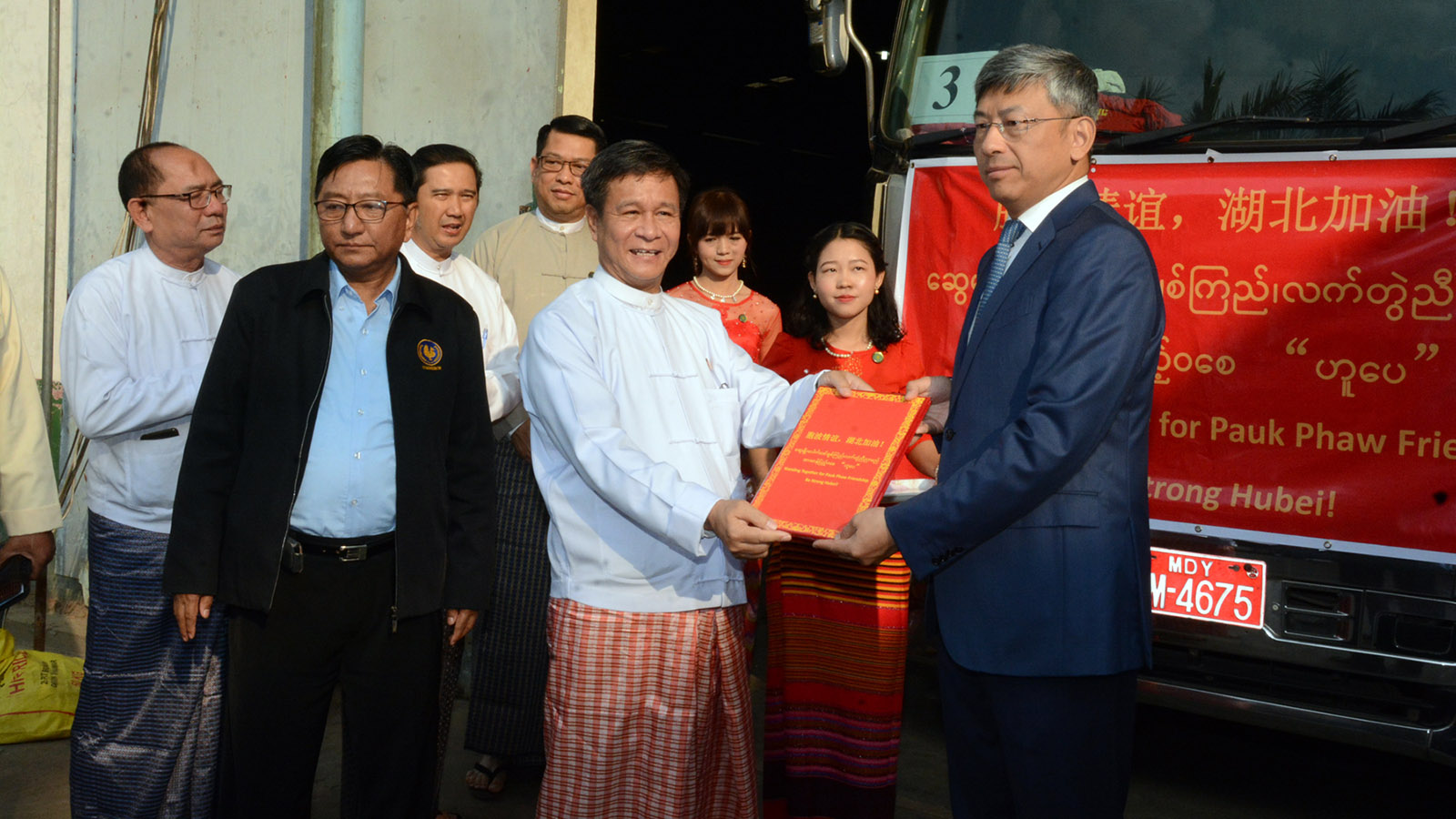 Deputy Minister U Aung Htoo hands over rice bags, and documents including certificates of laboratory tests for pest, aflatoxins, and chemicals to Chinese Ambassador Mr Chen Hai.Photo: Hla Moe