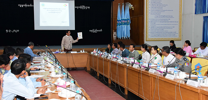Deputy Minister U Aung Hla Tun addresses the sixth coordination meeting at the Ministry of Social Welfare, Relief and Resettlement in Nay Pyi Taw yesterday.Photo: MNA