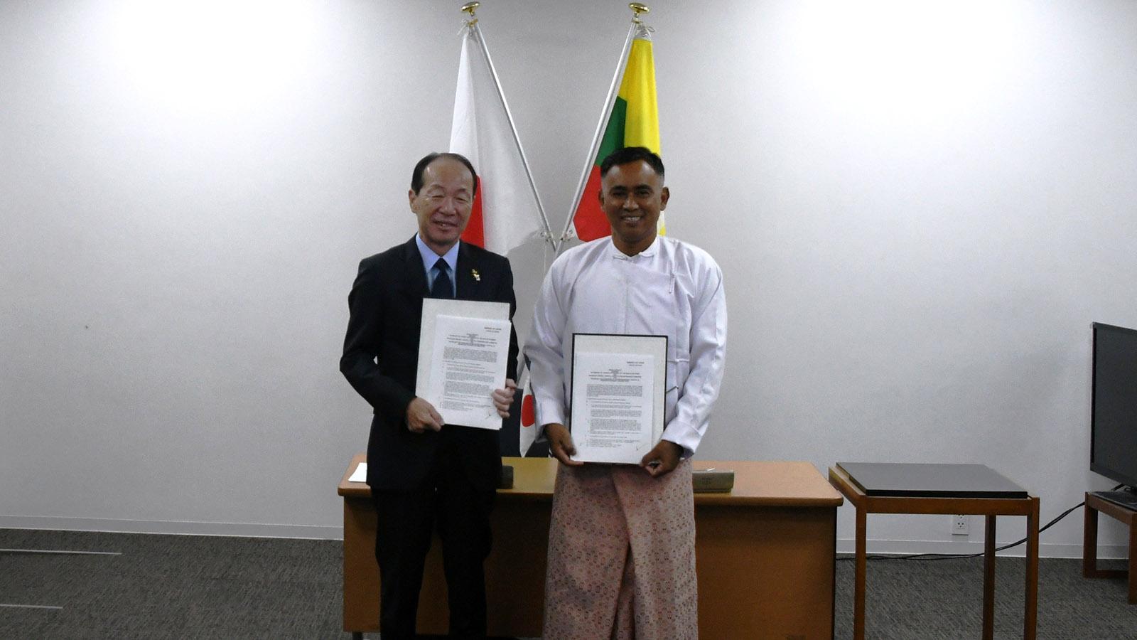 Amb. Mr Maruyama and U Hla Min pose for photo after signing the project on upgrading Maungtaw Hospital.Photo: Phoe Htaung