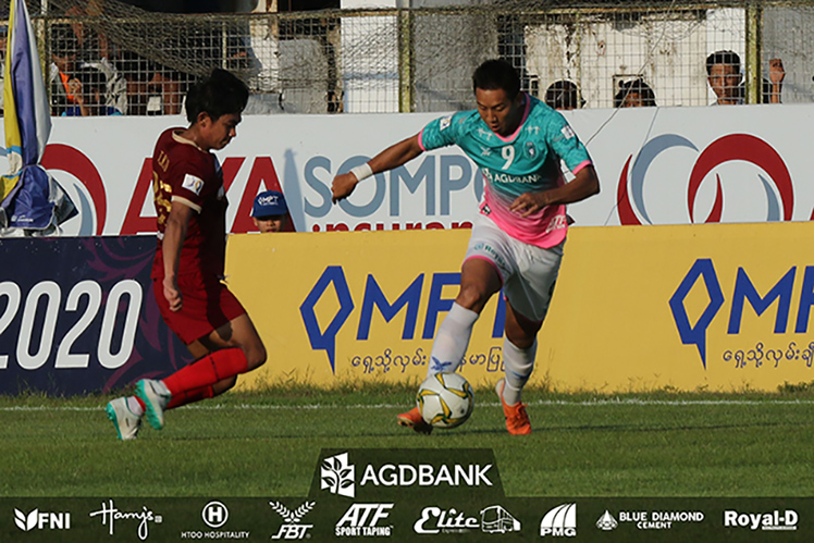 Yangon United's Than Paing attempts to pass Ayeyawady's defense during their week-9 match at Myanmar National League at Kyauk Taing Stadium in Pathein yesterday. Photo: YUFC