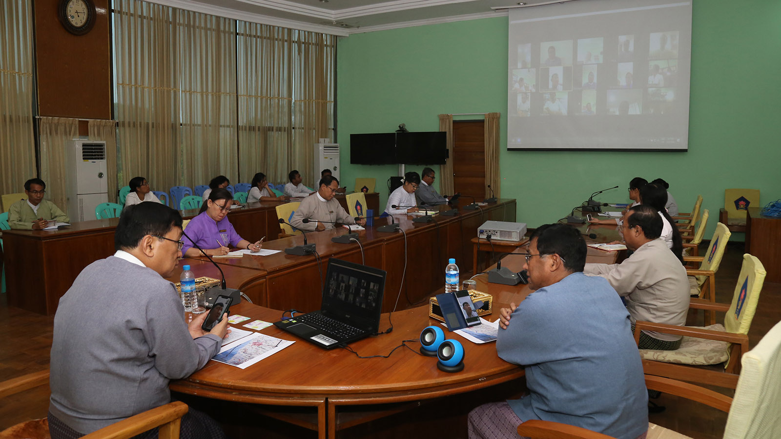 Union Minister Dr Win Myat Aye attends the video conferencing with the ministry's team in closing Kyauktalone IDP Camp in Nay Pyi Taw yesterday.Photo: MNA