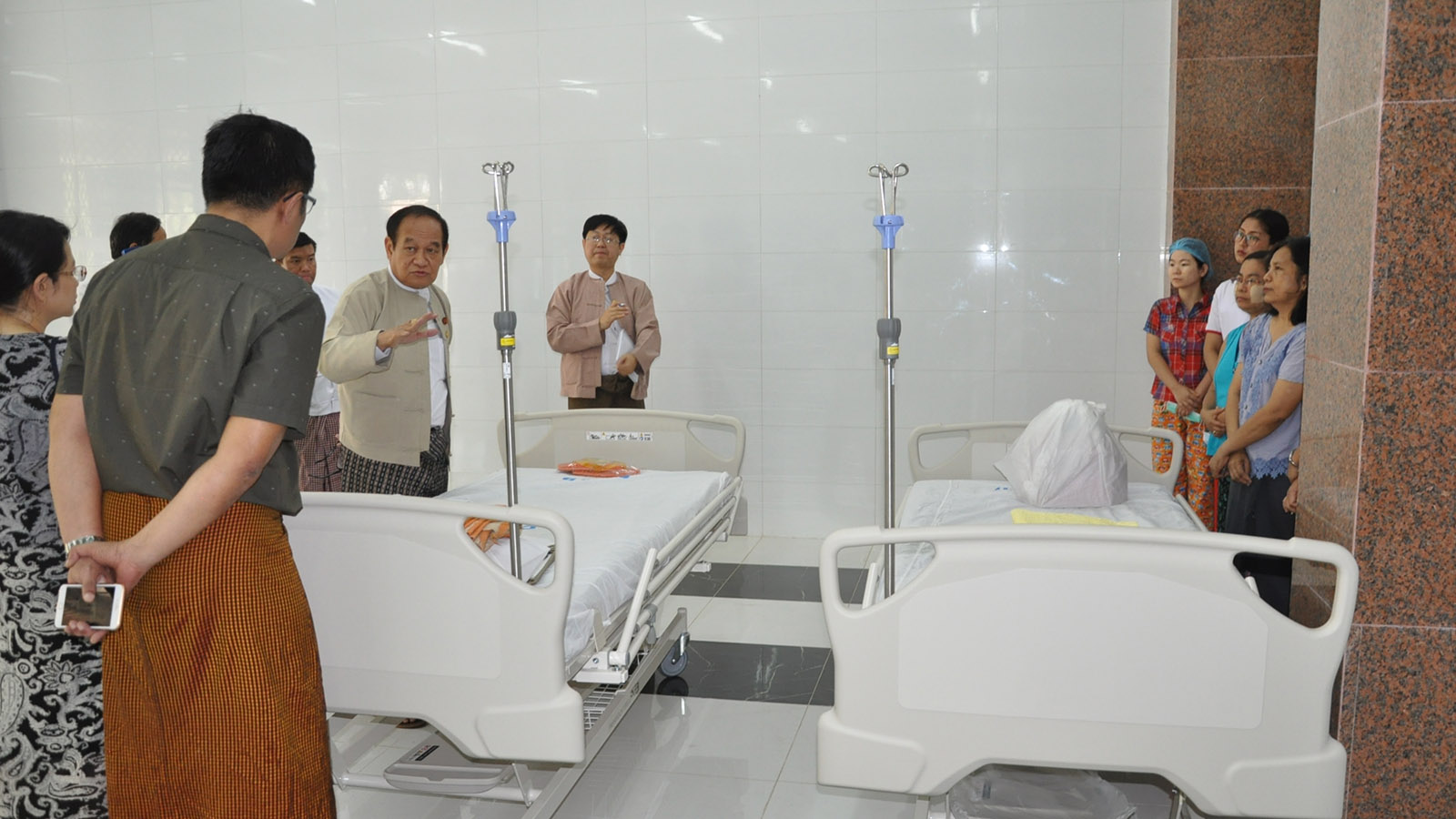 Union Minister Dr Myint Htwe inspects the South Okkalapa Women and Children's Hospital in Yangon yesterday. Photo: MNA
