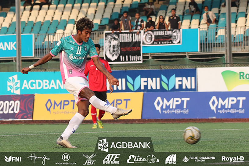 Yangon United's Mg Mg Lwin kicks the ball during a match against ISPE FC on 8 February at the Yangon United Sports Complex. Photo: YUFC