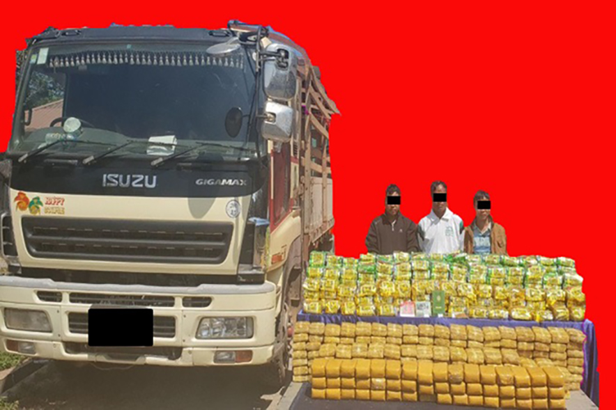 Suspects Maung Maung Lwin (a) Myint Zaw Lwin, Sai Hsan Paung and Sai Sein Win seen together with seized stimulant tablets, ICE and a vehicle.Photo: MPF
