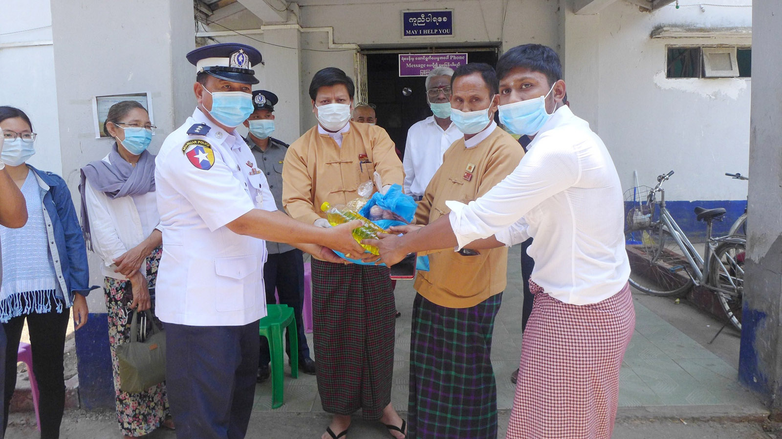 A man receives food aid from authorities in Dala Township. Photo: Naing Lin Kyaw