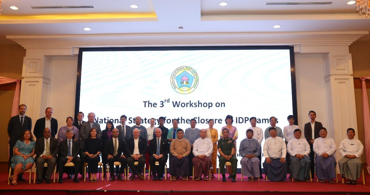 Union Minister Dr Win Myat Aye, and attendees pose for a group photo at the 3rd workshop on National Strategy for the Closure of IDP camps at the Horizon Lake View Resort Hotel in Nay Pyi Taw on 9 April 2019.