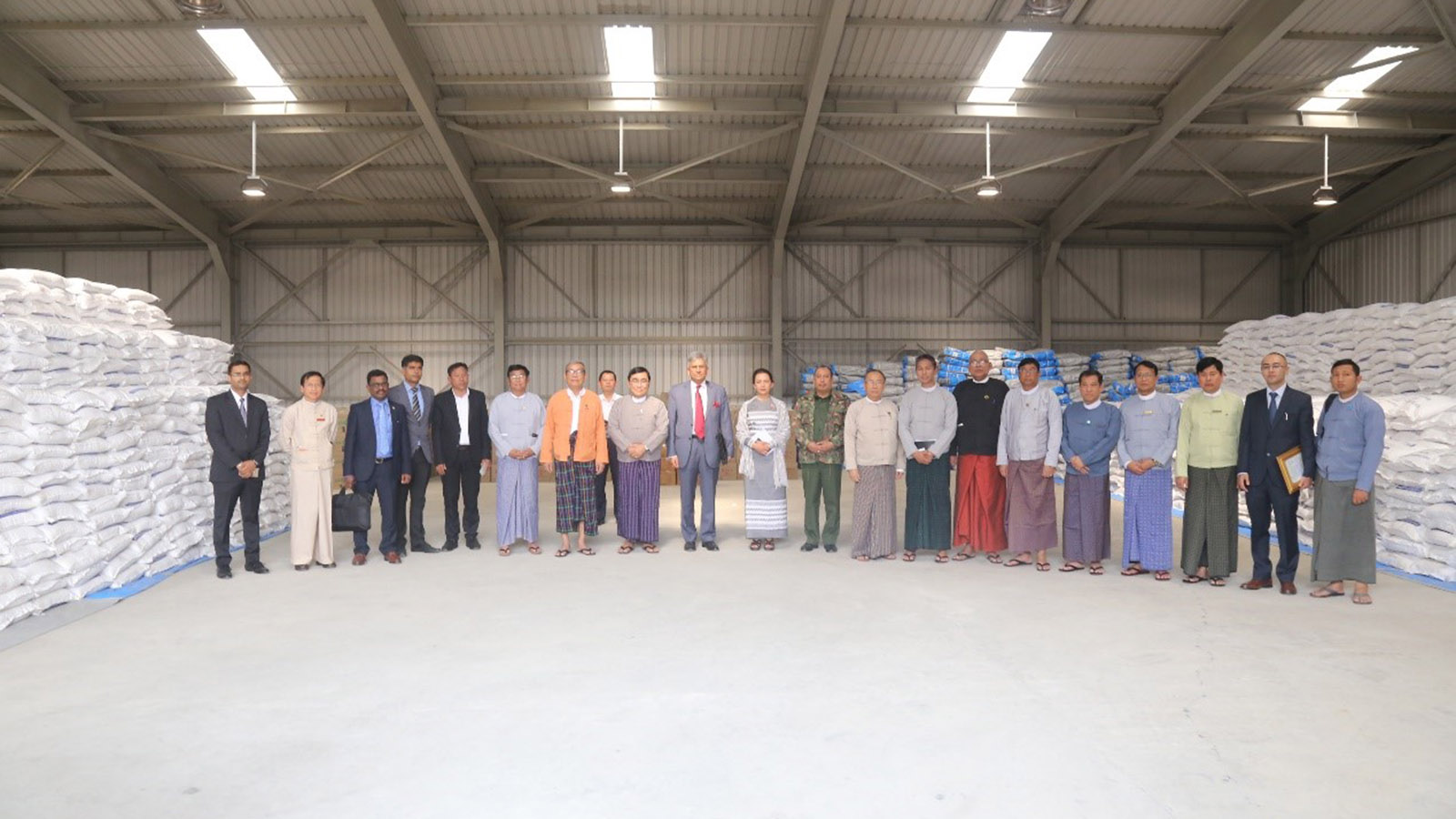 Union Minister Dr Win Myat Aye poses for a group photo at the ceremony to hand over the supplies donated by the Government of Indian at a port in Sittway on 21 January 2020.