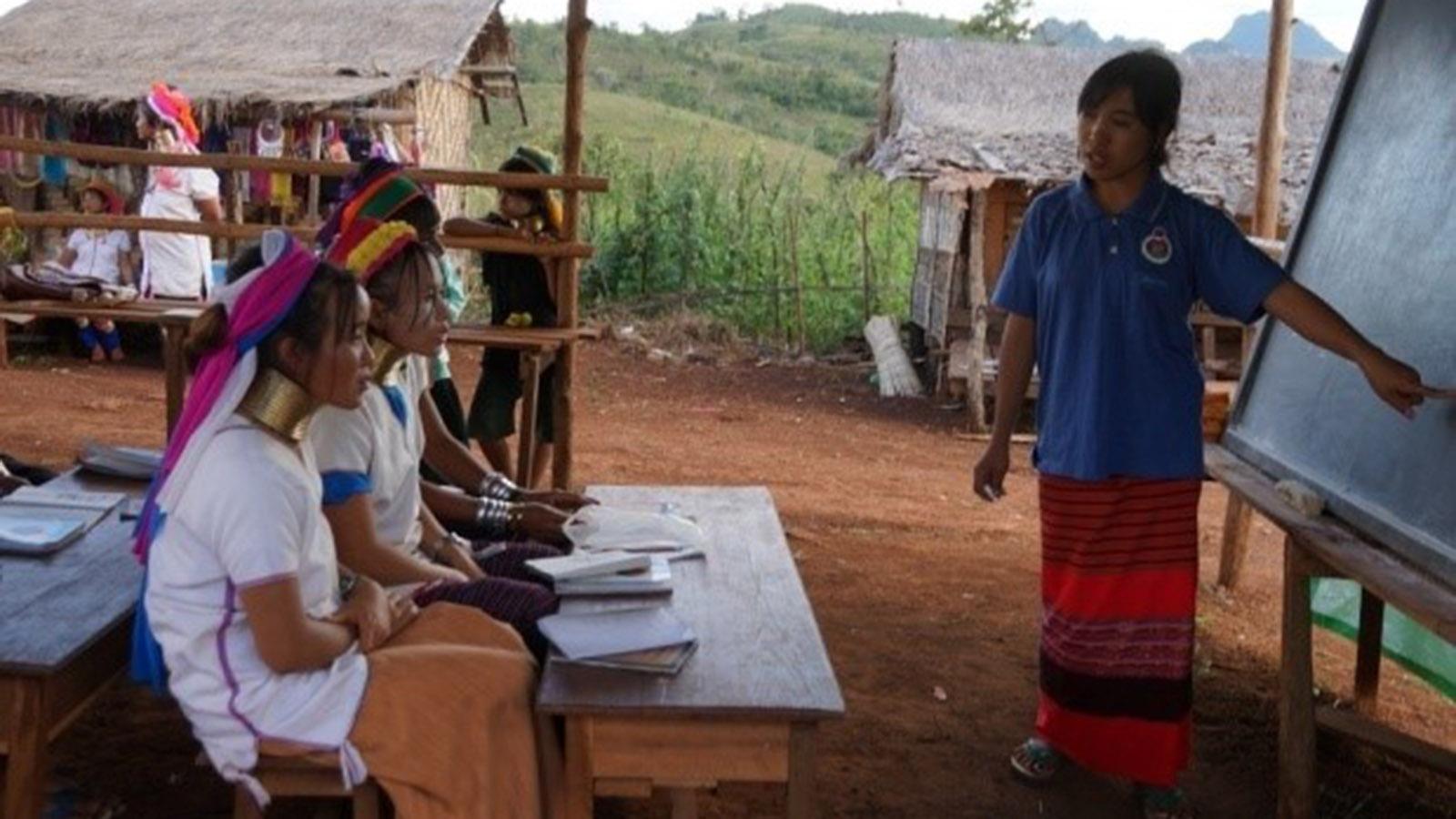 A teacher teaching the ethnic people in Panpat village, Kayah State.
