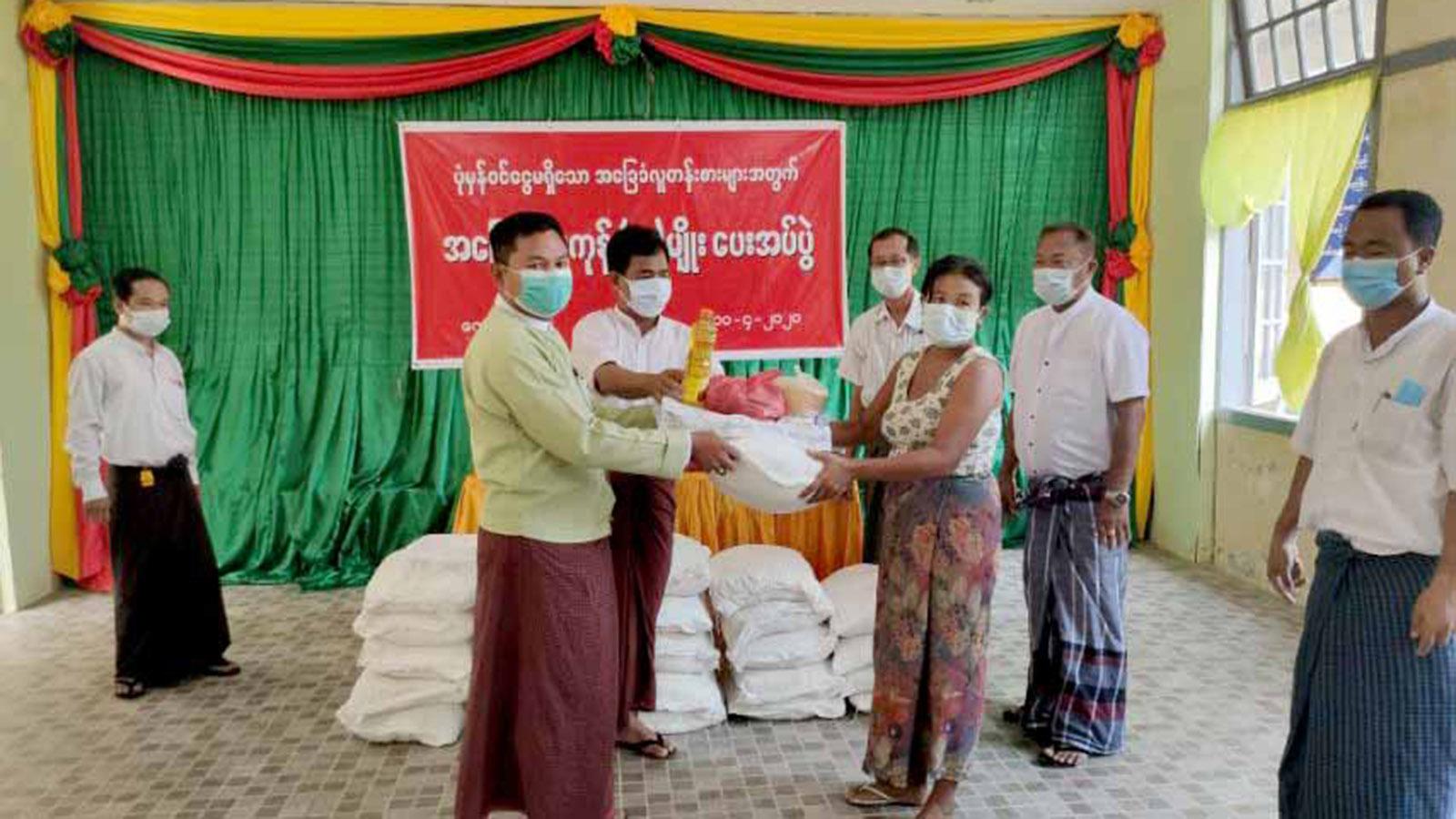 Rakhine authorities hand over food aid to local people. Photo: Tin Tun