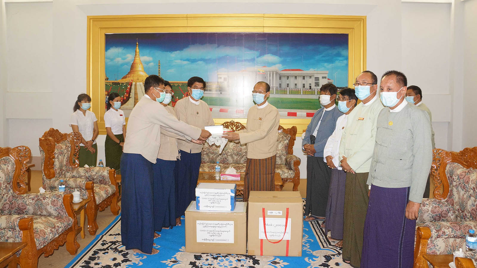 Dr Myo Aung receives donations of personal protective equipment and surgical masks to the Department of Public Health for efficient uses in Nay Pyi Taw.Photo: MNA