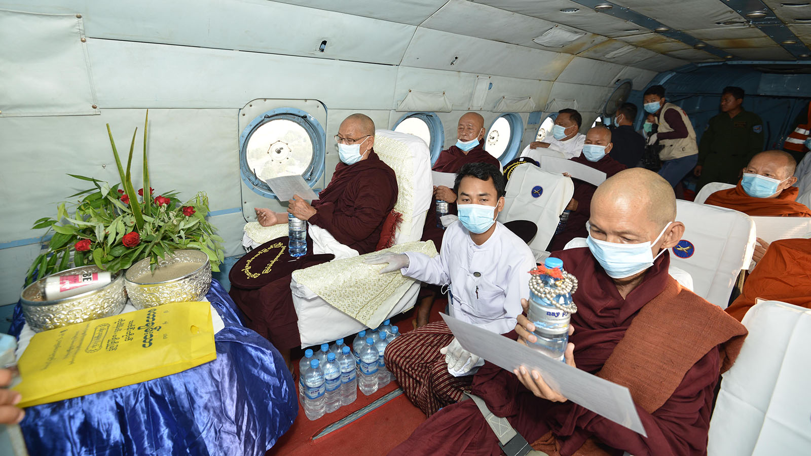 Senior Buddhist monks recite Parittas onboard a military helicopter over Nay Pyi Taw Council Area.  Photo: MNA
