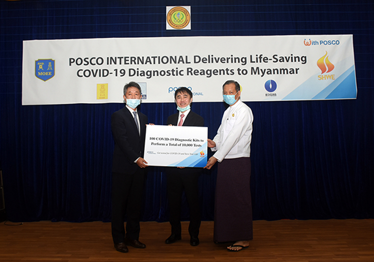 Professor Dr Zaw Than Htun accepts the diagnostic reagents handed over by Mr Lee Sang-hwa in Yangon yesterday.Photo Zaw Min Latt