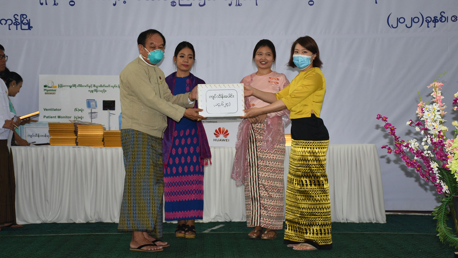 Union Minister Dr Myint Htwe receives the donations of cash and medical equipment for combating COVID-19 in Yangon yesterday. Photo: MNA