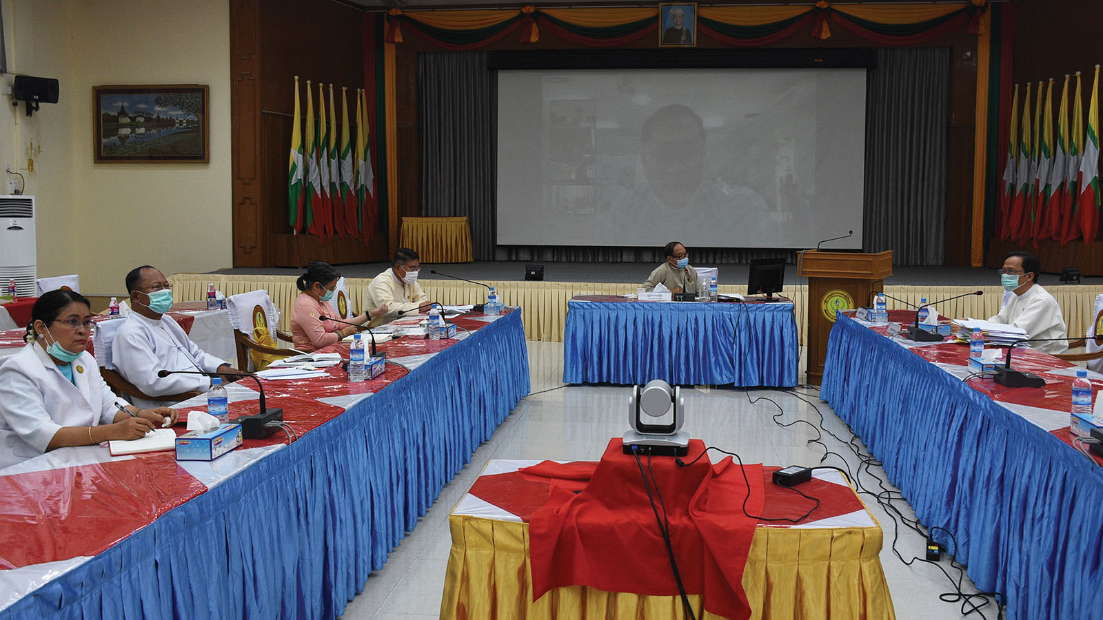 Union Minister Dr Myint Htwe attends a video conference with state/regional public health and medical services departments and various medical professionals yesterday. Photo: MNA