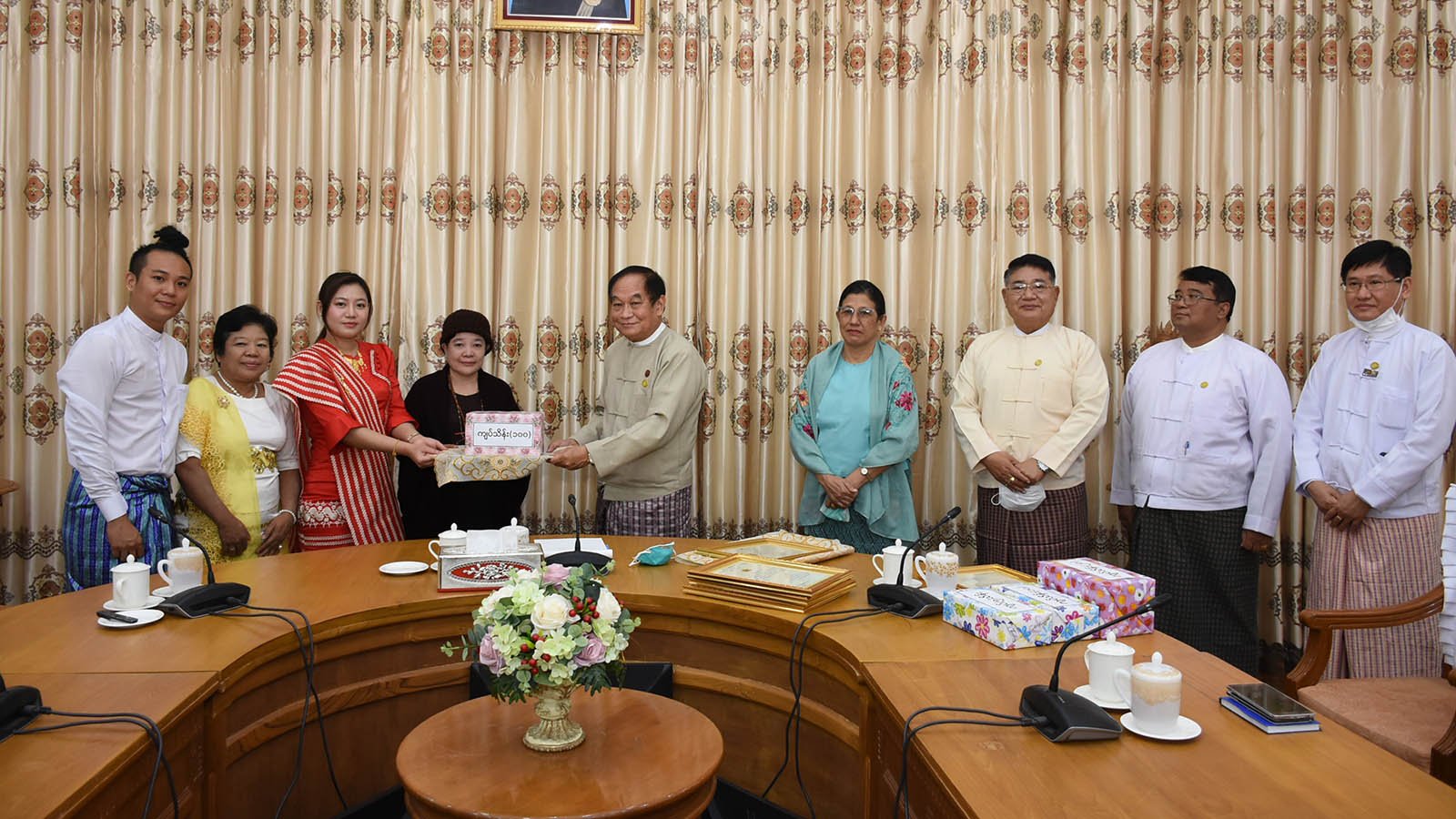 Union Minister for Health and Sports Dr Myint Htwe receives donations from well-wishers to the Department of Public Health for efficient uses in Nay Pyi Taw. Photo: MNA