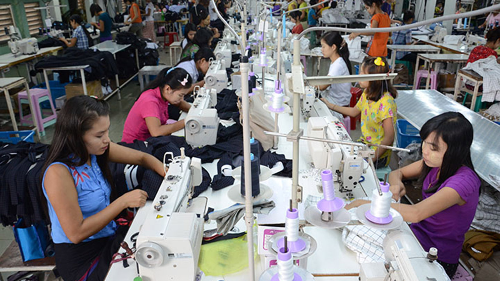 Textile workers sewing on production line at a garment factory in Hlinethaya Industrial Zone in Yangon. Photo: Phoe Khwar
