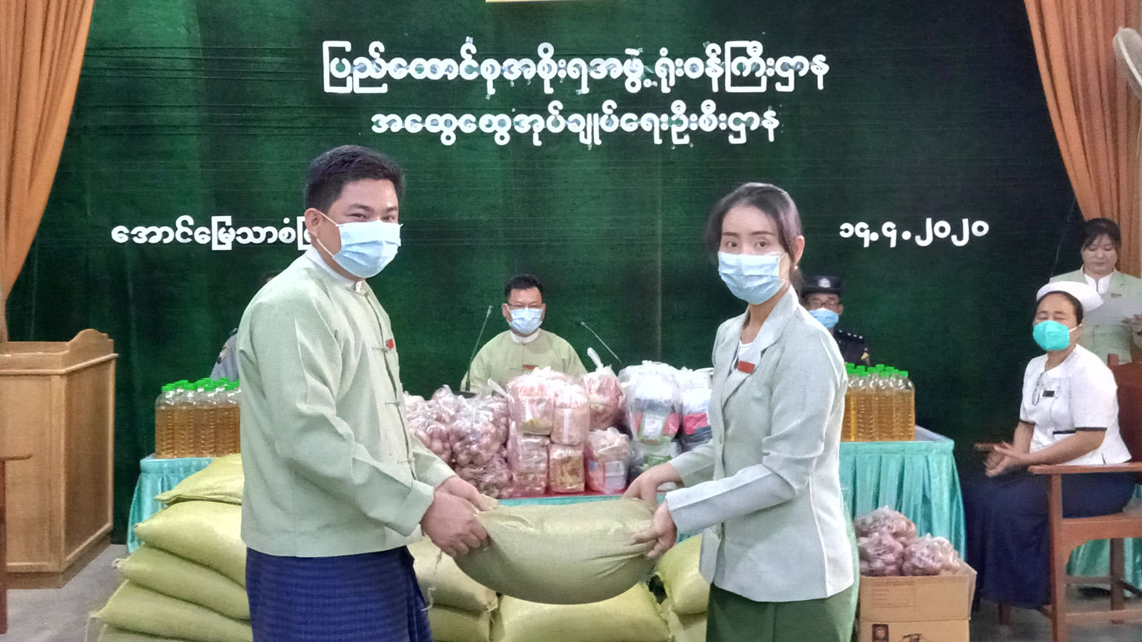 Mandalay Region Government giving foodstaffs to the civilian staff and their families.  Photo: Aung San