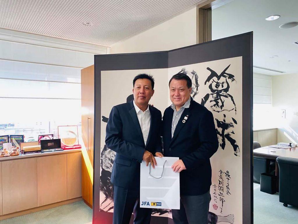File photo shows MFF president U Zaw Zaw (left) receiving a gift from JFA president Kozo Tashima in Japan in February 2020.Photo:MFF