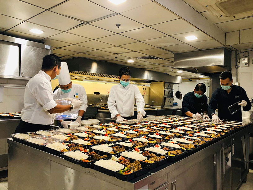 Chefs preparing the food boxes before sending them to the quarantined sites in Yangon. Photo: Ayeyarwady Foundation