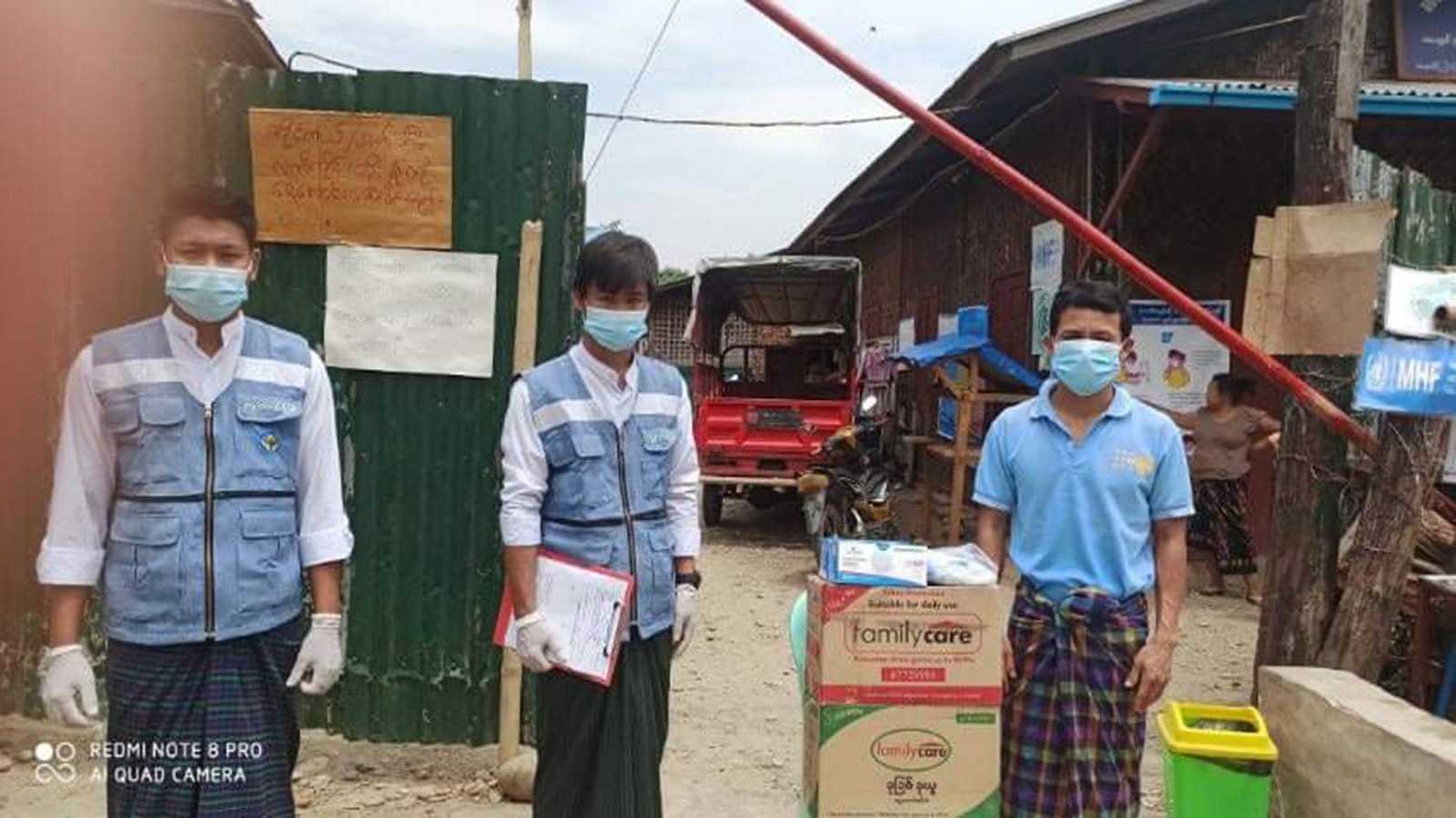 Officials from Ministry of Social Welfare, Relief and Resettlement offering boxes of face masks and soaps at the Internally Displaced Persons camp in Kachin State yesterday. Photo: MNA
