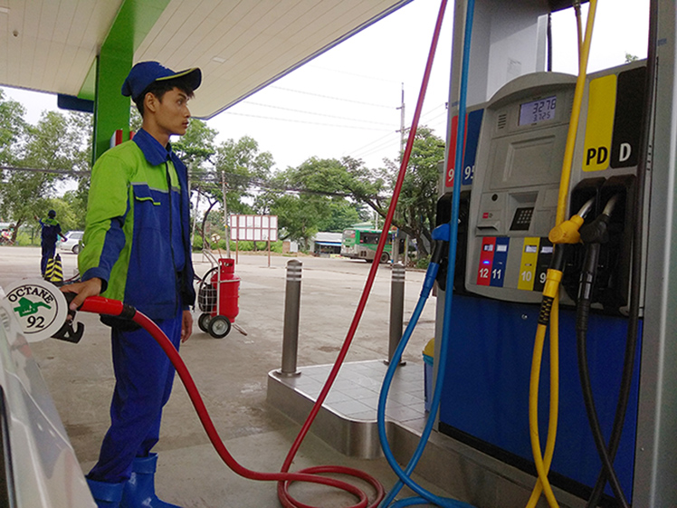 A man refilling the vehicle with fuel at a filling station in Yangon. Photo: Phoe Khwar