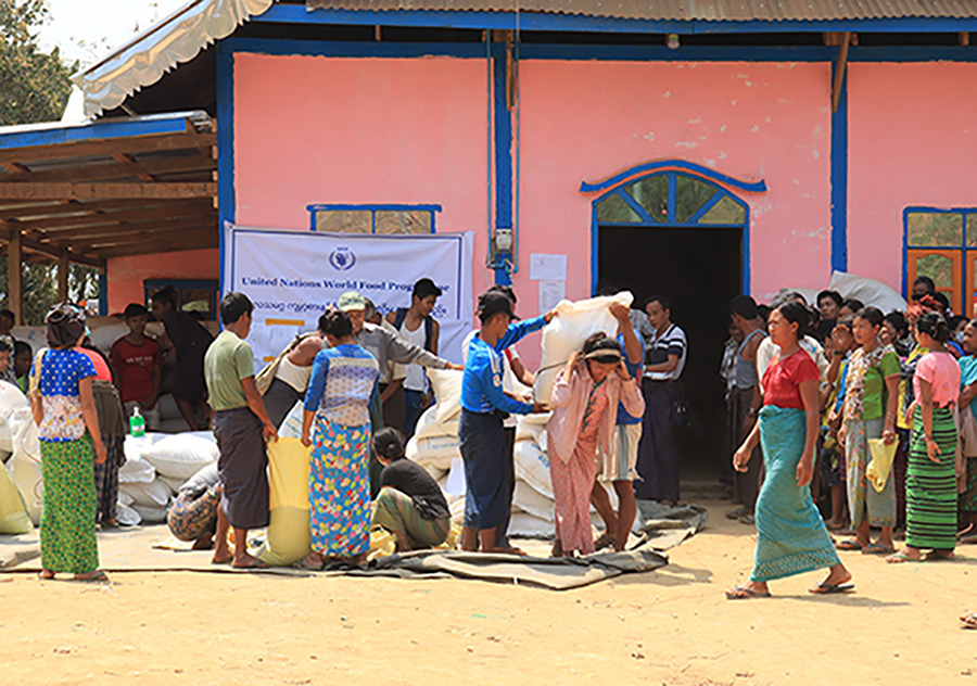 Displaced people in Paletwa receiving sacks of rice under the United Nations World Food Programme.   Photo : Supplied