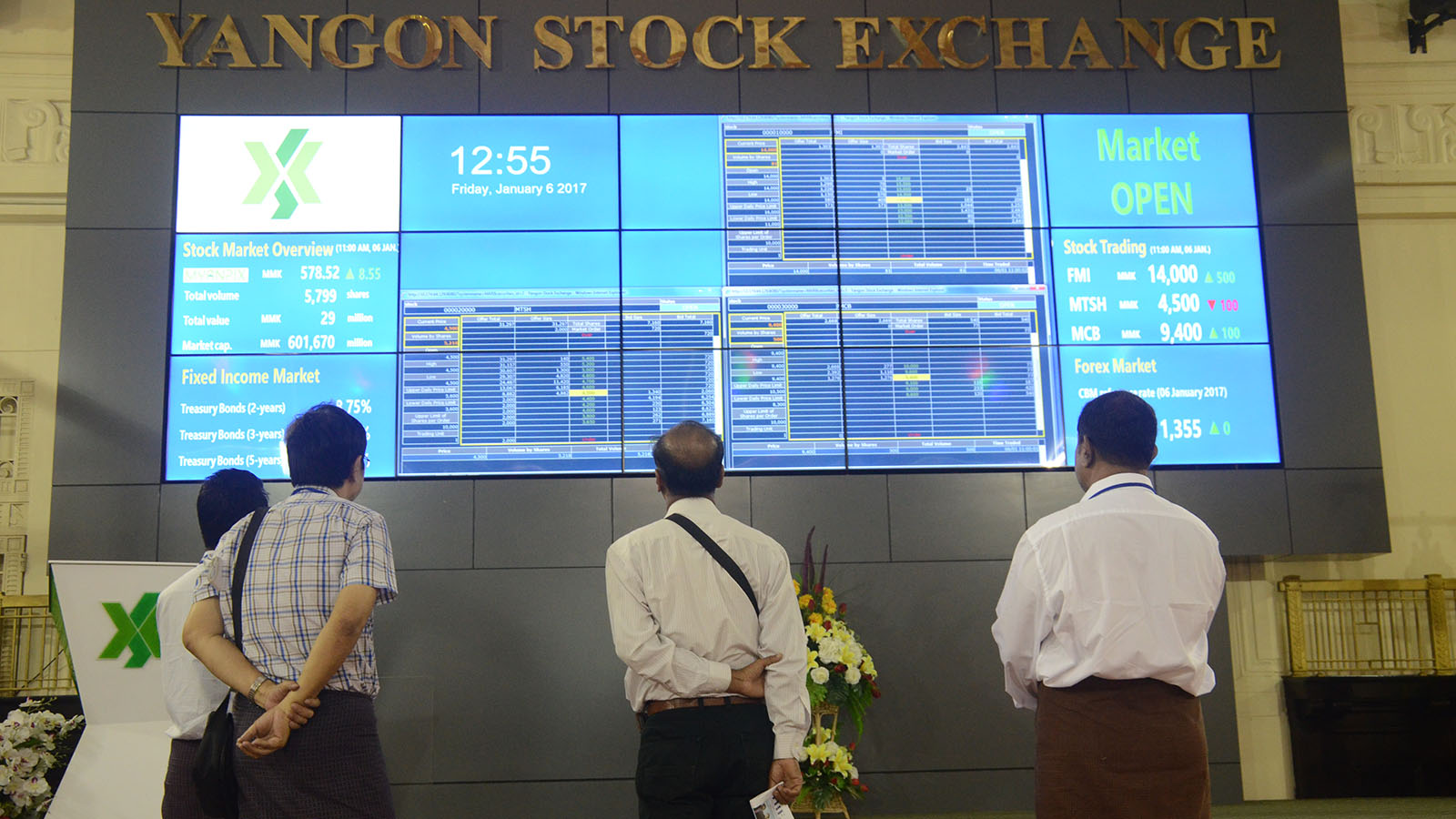 Visitors seen near the monitor screen of the Yangon Stock Exchange.Photo: Phoe khwar