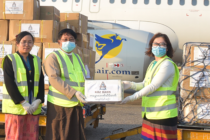 Daw Nang Lang Kham, Deputy CEO of KBZ Bank (right), hands over the donation of hospital equipment and supplies to Dr Tun Myint, at Yangon International Airport on 3 April. Photo: Supplied