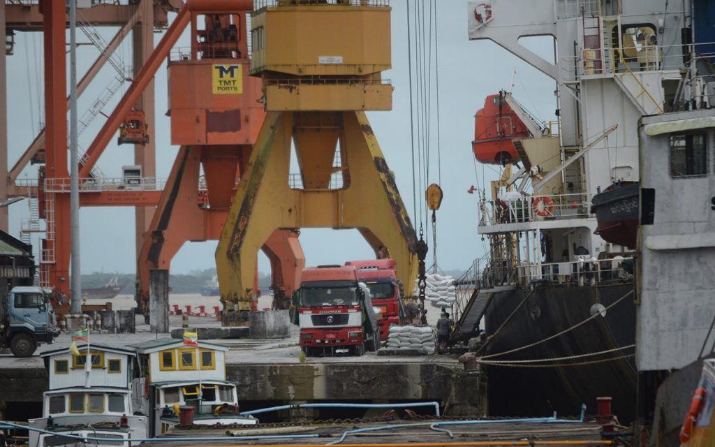Export rice is seen loading onto a vessel at Yangon Port. Photo: Phoe Khwar