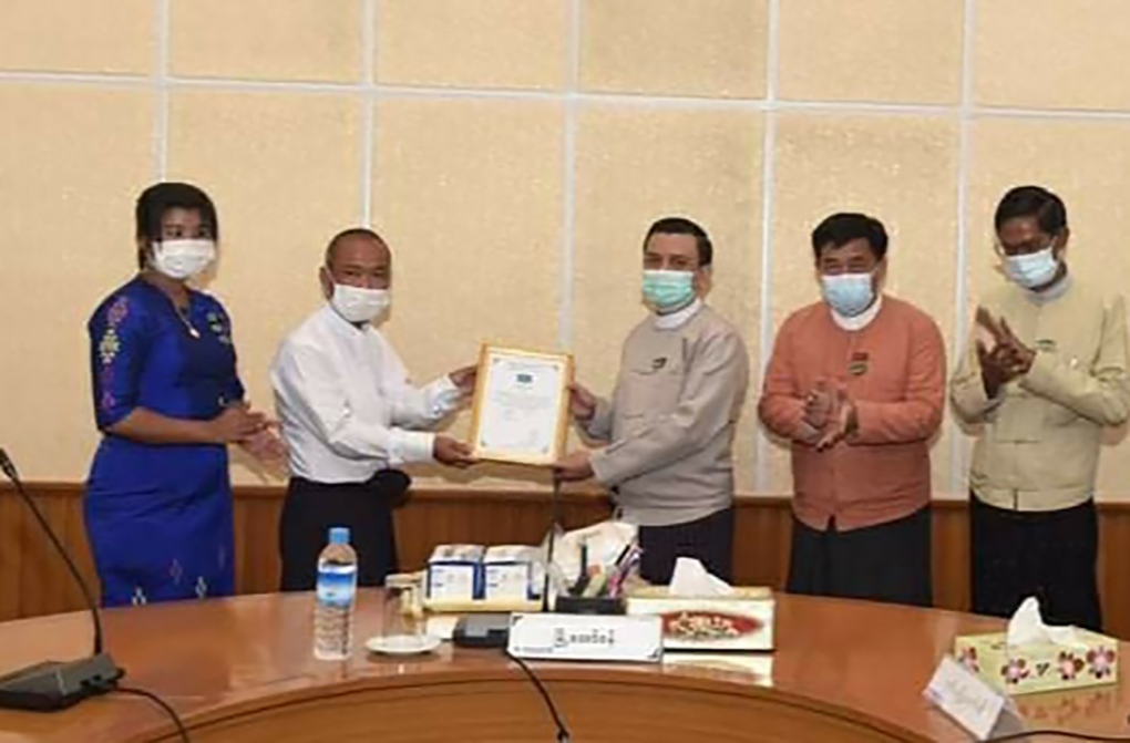 Myanmar China Association donating medical supplies to the Nay Pyi Taw Development Committee in Nay Pyi Taw on 21 May. Photo: Myint Maung