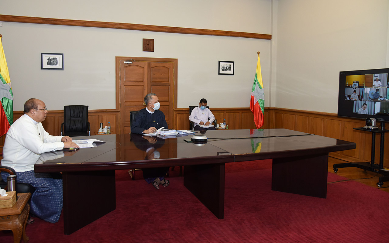Union Minister U Thaung Tun discusses the video conference to address impact of COVID-19 on Myanmar's economy. Photo: MNA