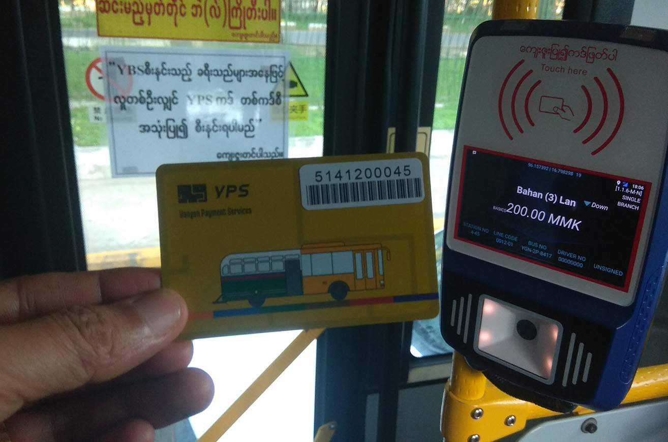 A customer uses YPS Card to pay for a YBS bus ride in Yangon on 24 July 2020. Photo : Phoe Khwar